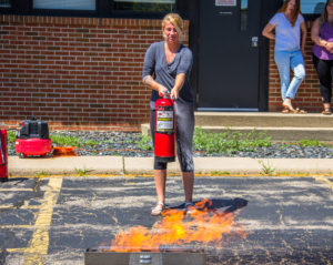 Woman Using Fire Extinguisher