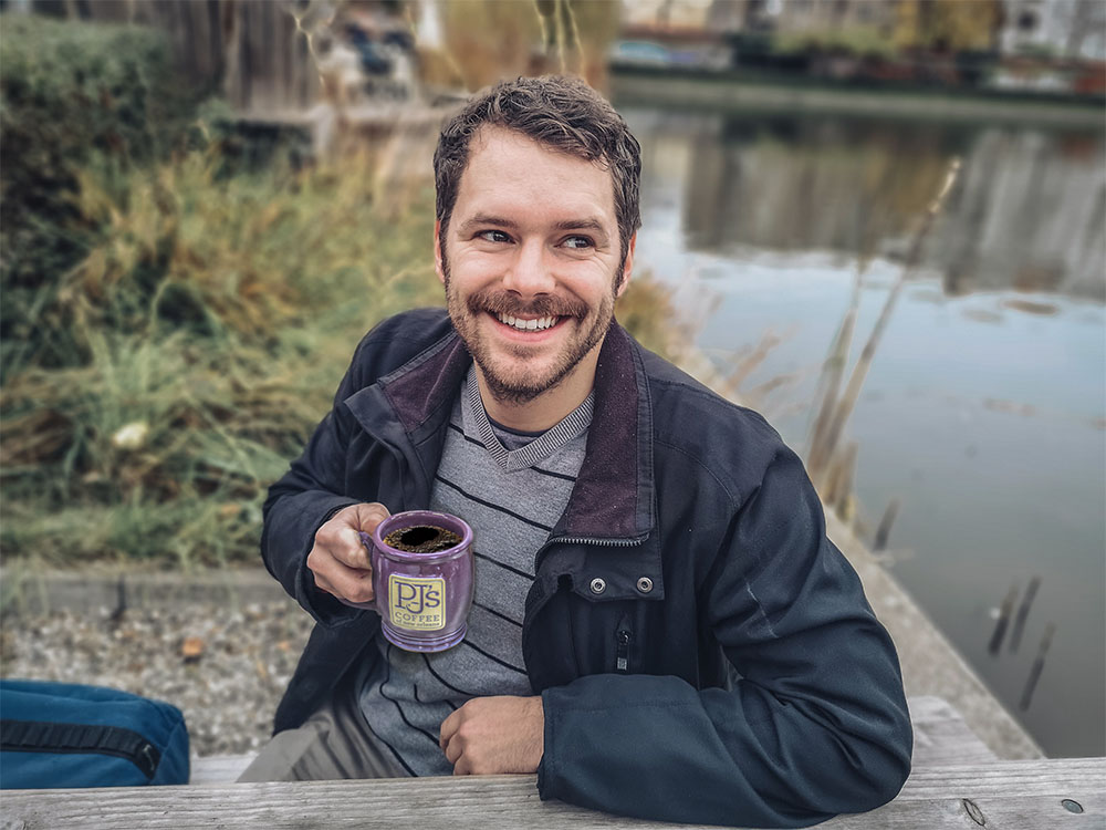 Man drinking coffee outside
