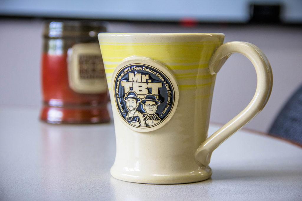 Yellow Swirlware logo coffee mug