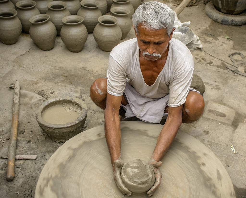 Potter making pottery in India
