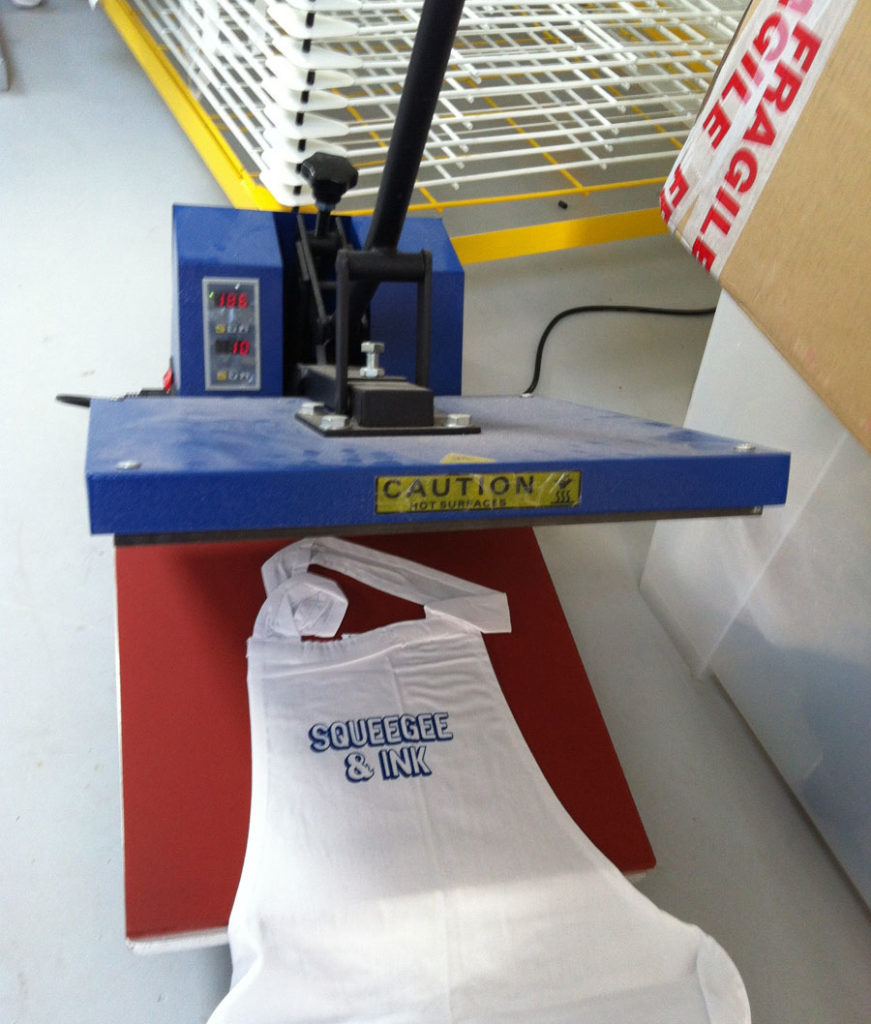 Heat press with apron